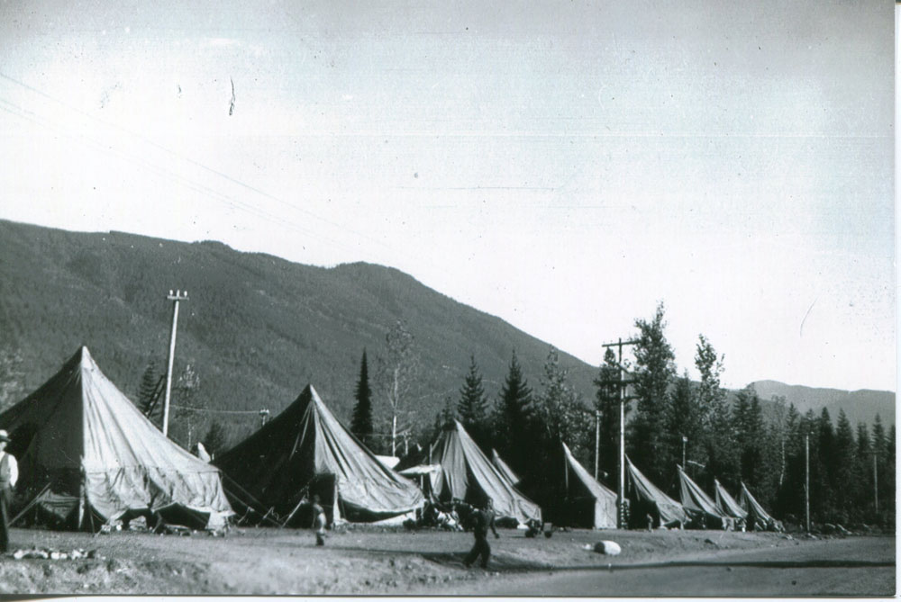 """Japanese """"Tent City"""" on the ground outside the old skating rink in the fall of 1942. """"The people had a terrible time surviving the cold and wetness as the water froze inside the tents. They had nothing but green wet wood to burn."""""""