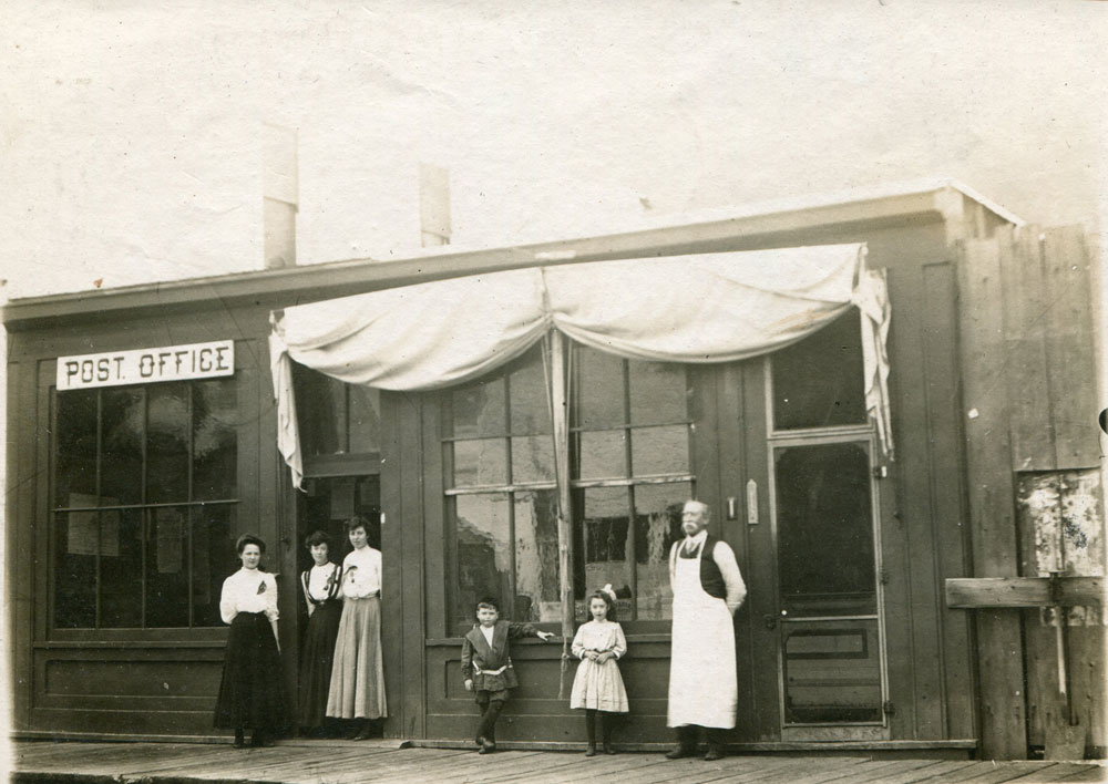 Slocan City's first post office on Main Street, circa 1900. First postmaster (on the right) Dunc McVannel