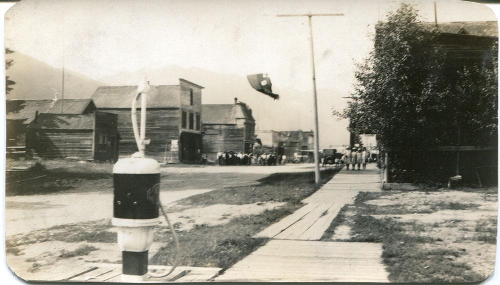 Main Street, Slocan City July 1, 1925. First gas pump for Fife's Garage.