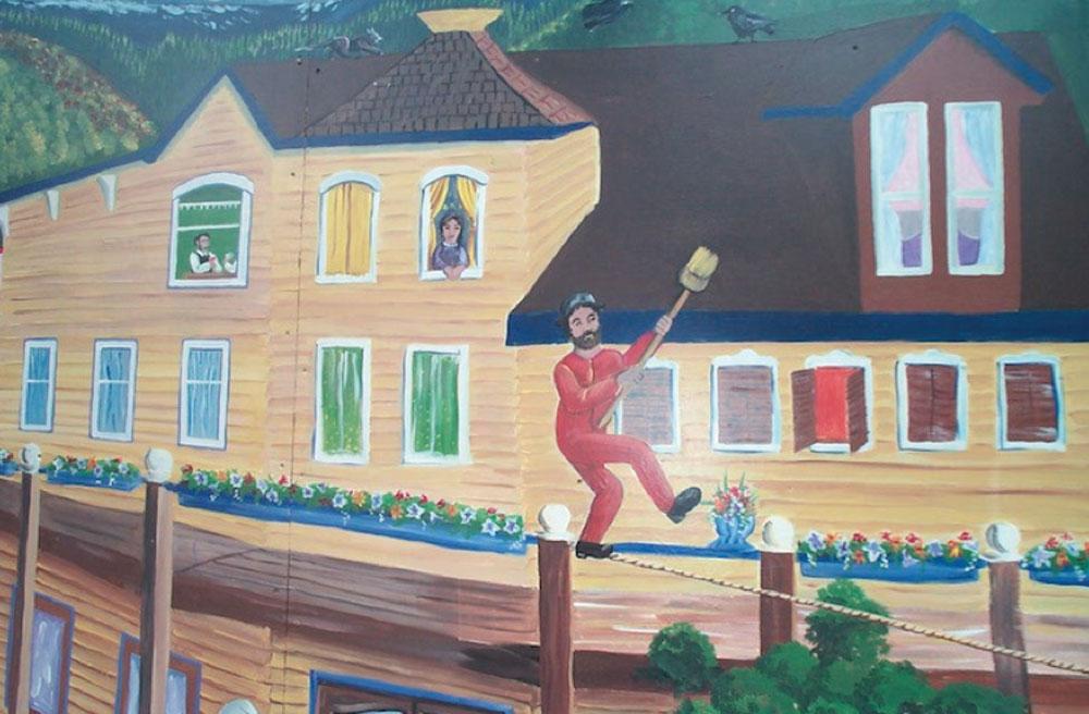Artistic rendition of Eli Carpenter's famous tightrope walk across Main Street in Slocan