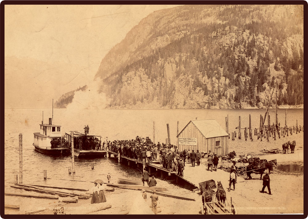 21 May 1897 - Sellling lots at Slocan City on the wharf with SS Hunter and barge in the background.