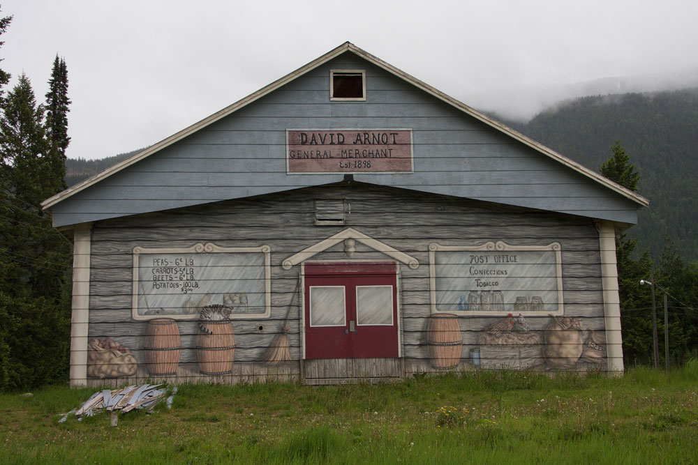 Slocan's Curling Rink with murals depicting businesses of the early years