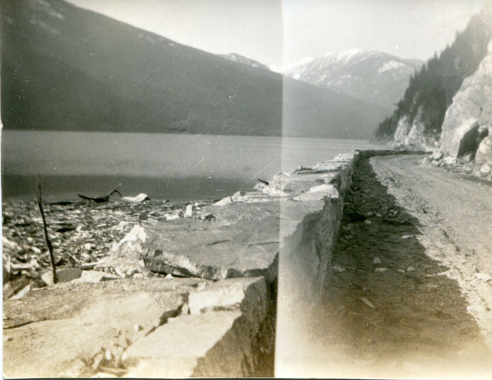 The construction of the Slocan-Silverton road is moving along, Easter 1928.