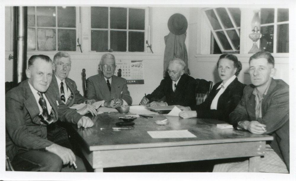 Slocan City Council, circa 1950. From left to right: John McDonell, Bob Warner, E. Denison (Mayor), Frank Norris (city clerk), Hazel O'Neail, Ted Hicks