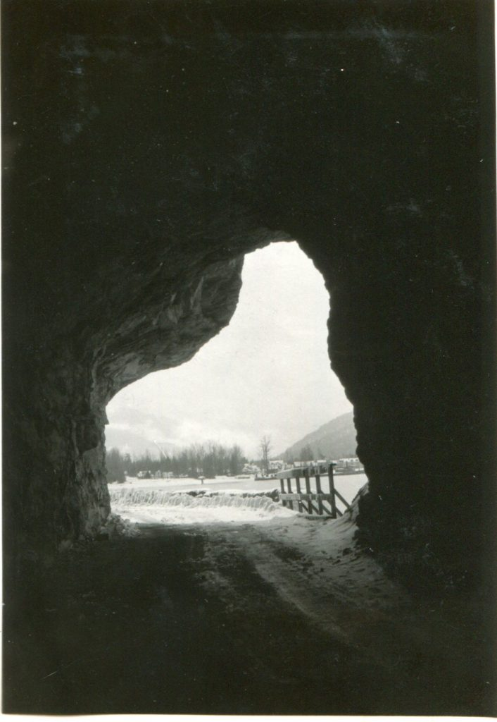 This photo taken from inside the tunnel shows Slocan in the distance, circa 1933