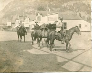 Lee Hall and Sam Long pack train, Main Street, Slocan City c.1900s