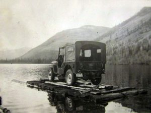 Rafting the 1947 Jeep across Beaver lake c1950